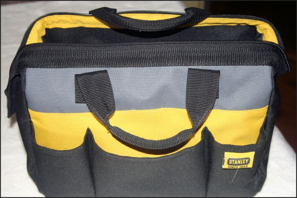This Stanley-brand bag is perfect for me to carry what I need!   Not expensive!  It's about the size of a ladies handbag.